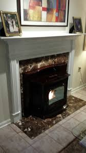 harman accentra pellet insert installed and finished w rettinger s own custom mantle marble surround