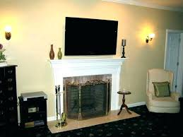 tv on top of fireplace simple fireplace mount tv above fireplace too high solutions