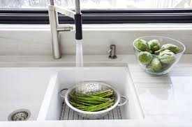 washing fresh asparagus in the kitchen sink