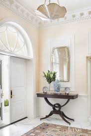 Traditional Cream Foyer with Crown Molding. This entry has so many elements  that I love.