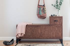 diy entryway bench with storage styled with plant shoes jacket and bag