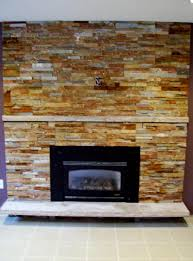 amazing stacked stone fireplace with small black electric gas fireplace without mantel as well as white