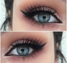 how to make your eyes look bigger try and avoid dark colors like blacks and grays