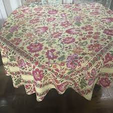 htf april cornell round tablecloth in golden yellow with pink orange flowers