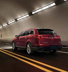 2018 lincoln mkt. contemporary mkt a lincoln mkt with the ruby red exterior color is seen being driven through  a brightly throughout 2018 lincoln mkt