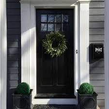 dramatic black front door eclecticallyvine rebuild front door entry front door