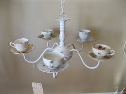 i thought this would be great as a bird feeder out in a garden or in a sunroom with votive candles in each cup