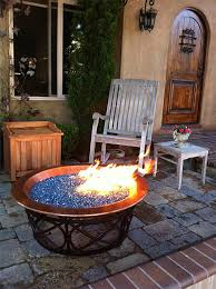 fire pit designed with cubs logo using electric blue alpine ruby red