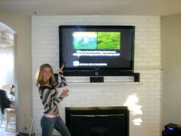 tv above fireplace wires above fireplace supreme hiding a flat