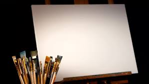 some equipment for painting rotation wooden easel and the blank canvas on it a lot of diffe and varicilired brushes isolated on black background