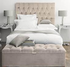 good looking bedroom design and decoration using cream velvet tufted  headboard including drum light grey bedside
