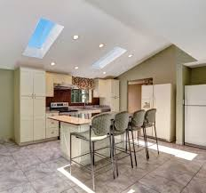 minimal lighting is required in this vaulted ceiling kitchen with glass sky windows