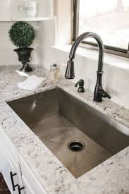 sophisticated granite countertop and dazzling stainless steel sink farm kitchen sink