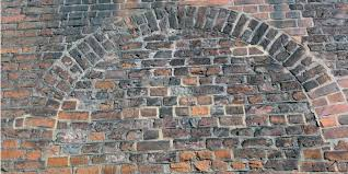 bowing brick wall repair what causes