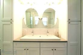 bathroom sink with two faucets trough