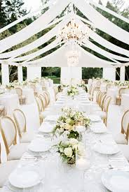 Almost all white wedding decor at this modern wedding at meadowood in Napa  Valley from a