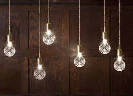 exposed lighting. pendant lighting with exposed crystal bulbs