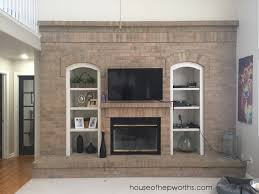 we have a nice big wall of brick in our living room some day iu0027d love to tear it all out and totally pimp this space but like shawty itu0027s very low fireplace makeover l96 brick