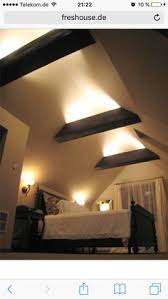 attic lighting. the exposed rafter beams mean greater ceiling height and they look cool could drop attic lighting