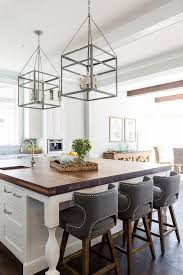 large white center island with stained wood countertop