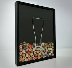 the beer cap collector shadow box is a box that you can hang on your wall that has glass front so that you can display all the beer caps from the all