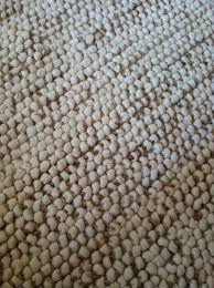 wool jute rug from the idea of bright red to a neutral with the mini pebble wool jute rug