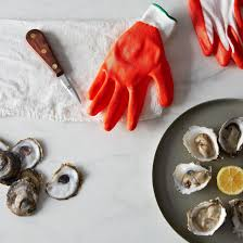 oyster glove knife and signed copy of shucked on food
