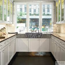 kraftmaid maple cabinetry in dove white traditional kitchen