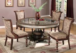 round white nail head trim and carved base glass dining table with four comfy chairs