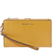 michael kors adele smartphone wristlet marigold item no 32t7gafw4l 706