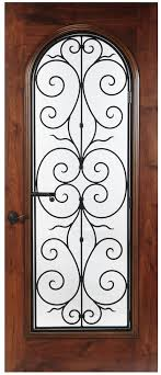 three small panels accent swirls of operable wrought iron are featured on this wood door with arched glass and square