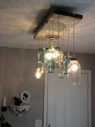 mason jar lighting diy. mason jar dining room chandelier maybe better suited for outdoor patio lighting great idea though diy e