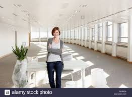 woman office furniture. Woman Unwrapping Office Furniture In Empty