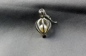 pearl cage pendent free tutorial with pictures on how to make a wire wrapped pendant