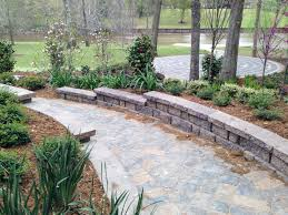 Stone pathway in downward slope with landscaping.