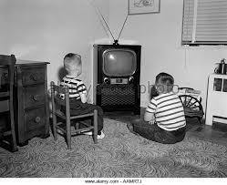 black kids watching tv. 1950s two boys sitting in living room watching television - stock image black kids watching tv c