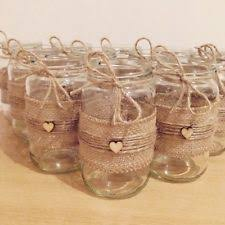 Decorated Jars For Weddings Lace hessian decorated Mason jam jars wedding centrepiece table 12