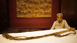after growing world s longest nails out of spite man sells 30 foot talons for enough to retire on