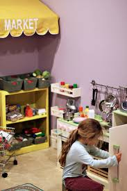 Playroom ideas. I'd love to get some of these racks for next to