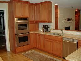 light wood kitchen with beige granite countertops