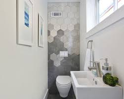 Small modern gray tile powder room idea in San Francisco with a wall-mount  toilet