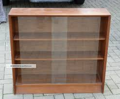 short brown wooden bookshelves comes with glass door bookcase and