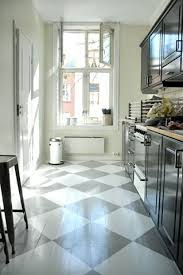 Fun painted wood floors, love the diagonal pattern to make a small galley  kitchen seem