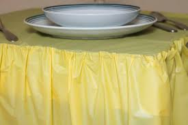 when budget and easy cleanup are a priority consider plastic table skirting vinyl fabric can be fashioned into simple gathers or knife pleats