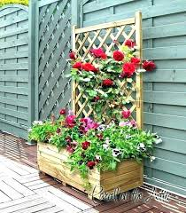 wooden planters with trellis garden arch arbor over high planter box