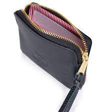 exposed metal zipper with knotted leather pull
