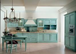 rustic kitchen and dining room spaces with old oak kitchen cabinet painted with light blue color and light brown ceramic backsplash plus white wall interior