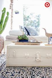 bright sunroom with vintage white trunk white couches blue accents and succulents