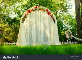 Wedding Arch Decorations Wedding Arch Flowers On Grass Stock Photo 104983745 Shutterstock