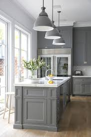 Grey cabinets, marble counter tops, French doors, and a sweet Sub-Zero